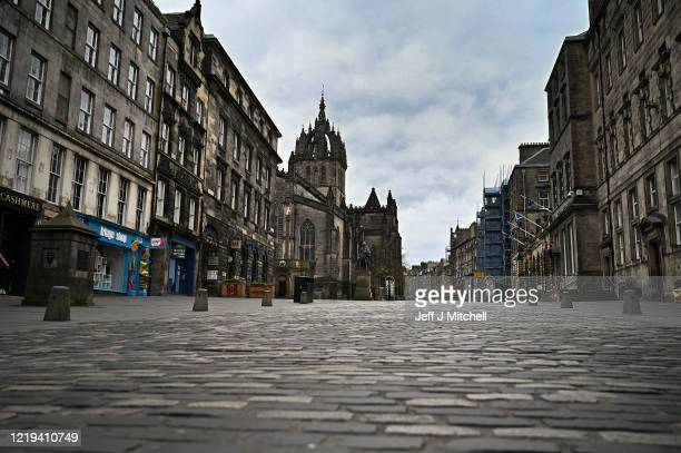 Members of the public are seen out on the Royal Mile during the coronavirus pandemic on April 17 2020 in Edinburgh Scotland The Coronavirus pandemic...
