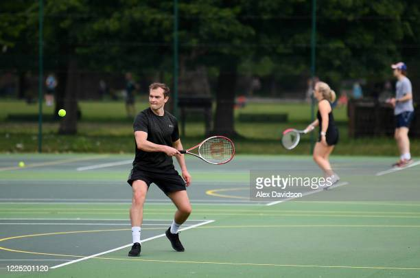 Members of the public are seen playing Tennis at Kennington Park Courts on May 16 2020 in London England The prime minister announced the general...