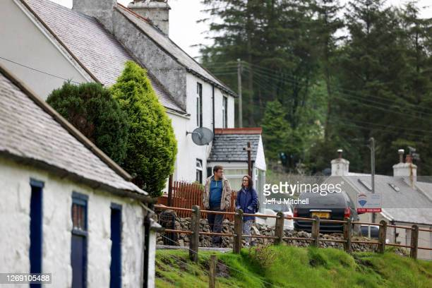 Members of the public are seen walking in Scotland's highest village on August 27, 2020 in Wanlockhead, Scotland. Following 4 years of negotiations,...