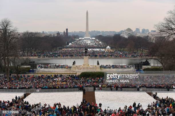 TOPSHOT Members of the public arrive on the Mall in Washington DC on January 20 before the swearingin ceremony of US Presidentelect Donald Trump /...