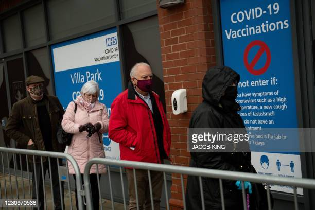 Members of the public arrive to receive a dose of a Covid-19 vaccine, at a temporary coronavirus vaccination hub set up at Villa Park football...