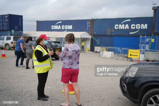 Members of the public arrive to receive their Covid vaccinations at the Stithians Showground temporary NHS vaccination centre during its final hour...