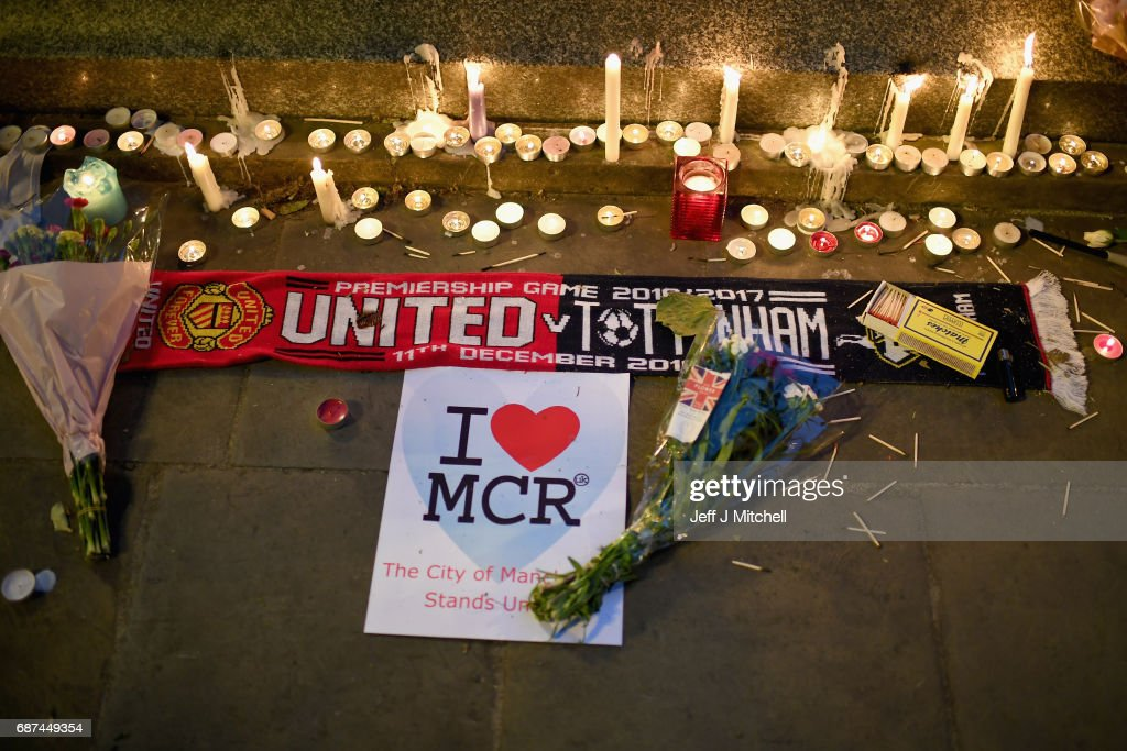 Members of the public attend a candlelit vigil, to honour the victims of Monday evening's terror attack, at Albert Square on May 23, 2017 in Manchester, England. Monday's explosion occurred at Manchester Arena as concert goers were leaving the venue after Ariana Grande had just finished performing. Greater Manchester Police are treating the explosion as a terrorist attack and have confirmed 22 fatalities and 59 injured.