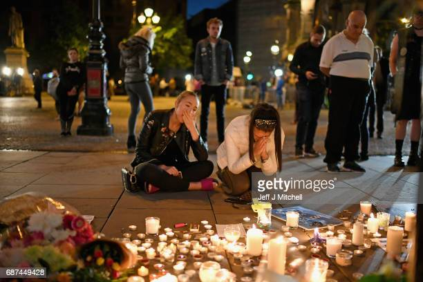 Members of the public attend a candlelit vigil to honour the victims of Monday evening's terror attack at Albert Square on May 23 2017 in Manchester...