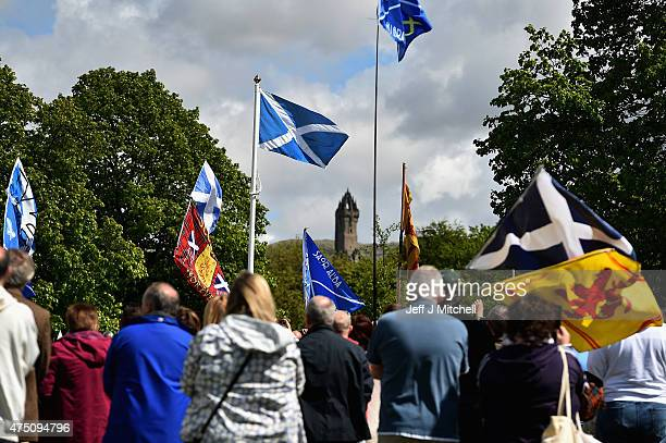 Members of the public attend a ceremony at the Stirling Bridge Battle Site as the Saltire was raised for the first time in 700 years on May 29 2015...