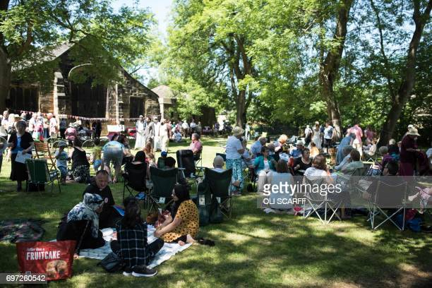 Members of the public attend a 'Great Get Together' community service and picnic in memory of murdered Member of Parliament Jo Cox marking the first...