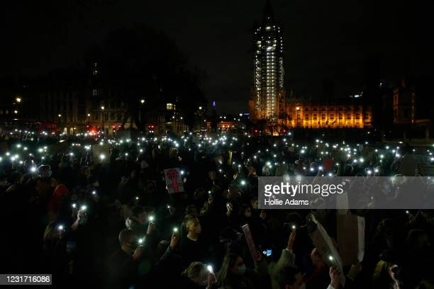 Members of the public attend a protest criticising the actions of the police at last night's vigil on Parliament Square Garden on March 14, 2021 in...