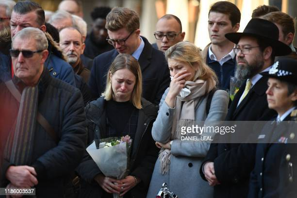 Members of the public attend a vigil at the Guildhall in central London to pay tribute to the victims of the London Bridge terror attack on December...