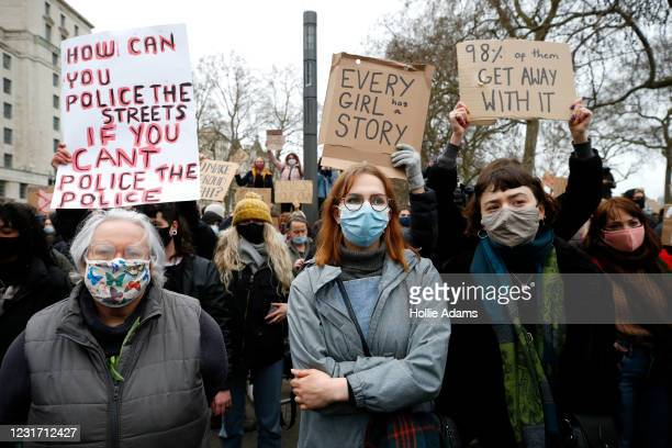 Members of the public attend a vigil organised by feminist group Sisters Uncut outside New Scotland Yard on March 14, 2021 in London, England....