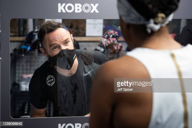 Members of the public attend the first class at the reopening of KOBOX Chelsea on July 25 2020 in London England Gyms swimming pools and indoor...