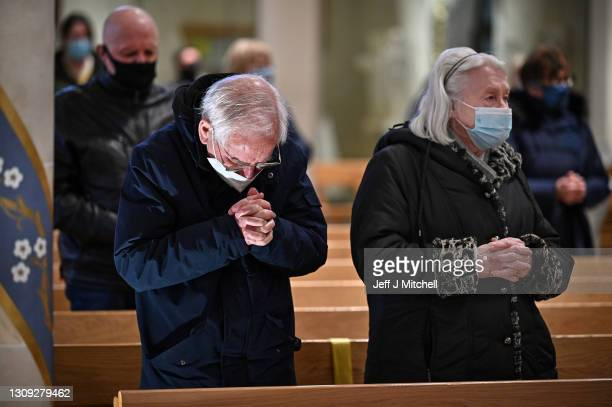 Members of the public attend the first mass conducted by Canon Gerard Sharkey at St Andrews cathedral on March 26, 2021 in Glasgow, Scotland....