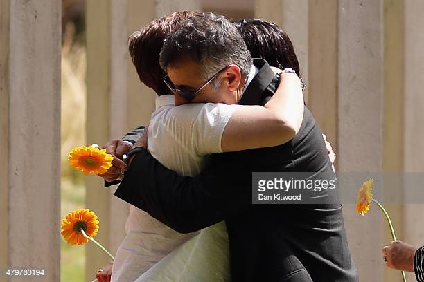 Members of the public attend the memorial to the victims of the July 7 2005 London bombings in Hyde Park on July 7 2015 in London England Today is...