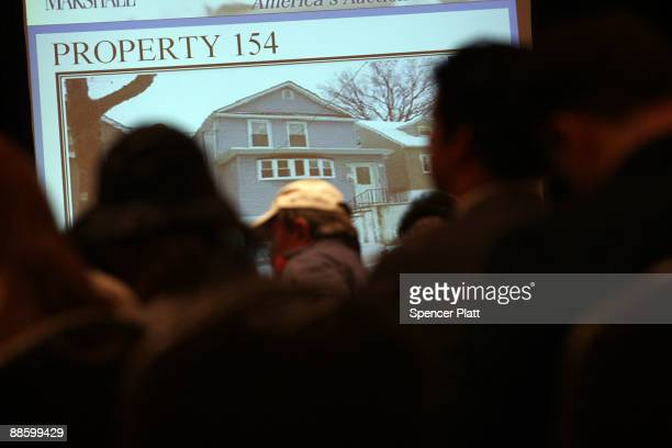 Members of the public bid at an auction for more than 25 foreclosed homes by auctioneers from Hudson Marshall at the Renaissance Newark Airport Hotel...