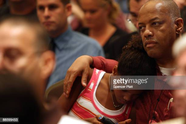 Members of the public bid at an auction for more than 25 foreclosed homes at the Renaissance Newark Airport Hotel on June 20 2009 in Elizabeth New...