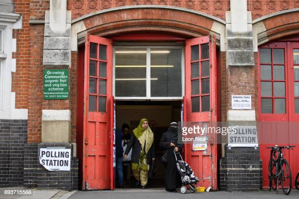 Members of the public cast their votes at a former fire station on June 8 2017 in London United Kingdom Polling stations have opened as the nation...