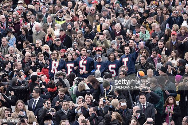 TOPSHOT Members of the public chant slogans and display tshirts reading 'resist' during a protest at the beginning of the swearingin ceremony of...