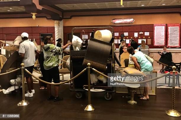 Members of the public check out after purchasing items during the third day of a liquidation sale at the former Trump Taj Mahal Casino and Resort in...
