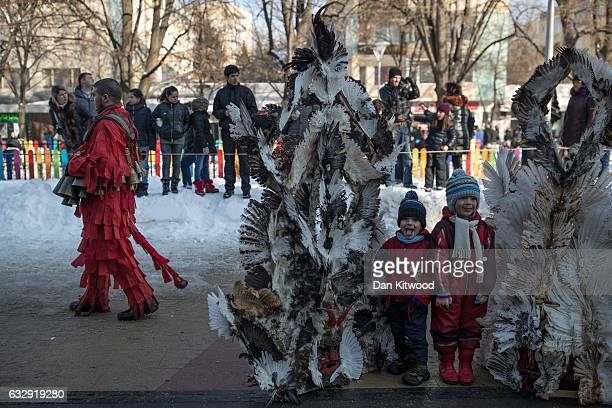 Members of the public check out two giant feather headpieces on the first day of the annual Surva International Festival of the Masquerade Games on...