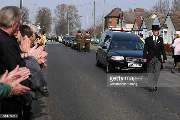 Members of the public clap as the funeral cortege of Sapper Mark Quinsey who was murdered in Northern Ireland arrives at Immanuel Church in Highters...
