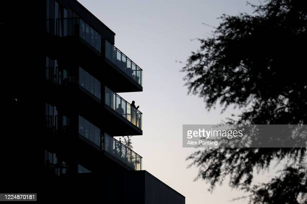 Members of the public clap from their balconies in Hackney Wick on May 14 2020 in London United Kingdom Following the success of the Clap for Our...