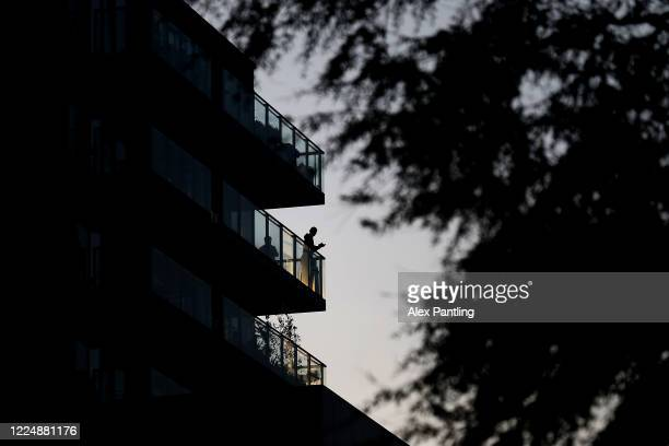 Members of the public clap from their balconies on the River Lee in Hackney Wick on May 14 2020 in London United Kingdom Following the success of the...