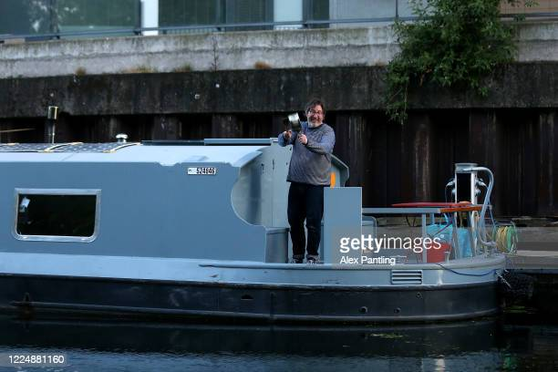 Members of the public clap from their boats on the River Lee in Hackney Wick on May 14 2020 in London United Kingdom Following the success of the...