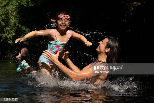 Members of the public cool off in the River Lea on May 21 2020 in London United Kingdom This week temperatures reached 28 degrees celsius in the UK...