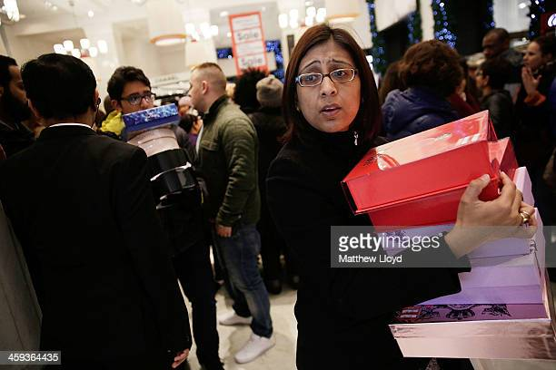 Members of the public cram into Selfridges for the Boxing Day sales on December 26 2013 in London England Statistics have shown that this year people...