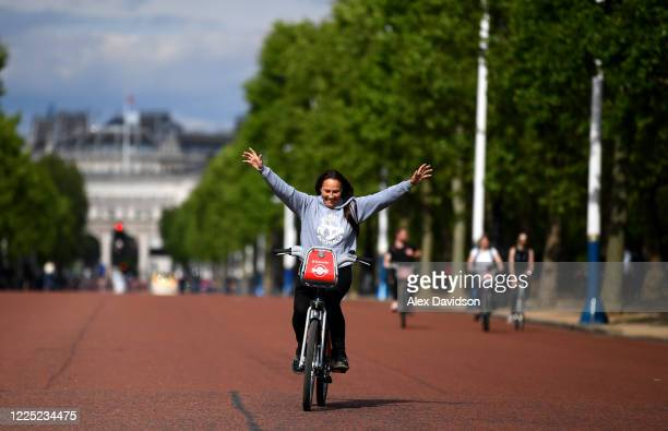 Members of the public cycle down The Mall on May 16 2020 in London England The prime minister announced the general contours of a phased exit from...