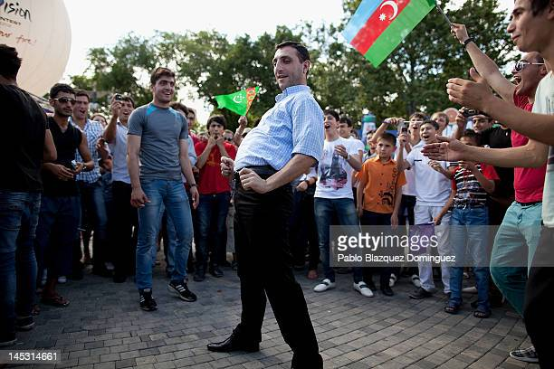 Members of the public dance in the streets hours before the Eurovision Song Contest Grand Final at Euro Village on May 26 2012 in Baku Azerbaijan