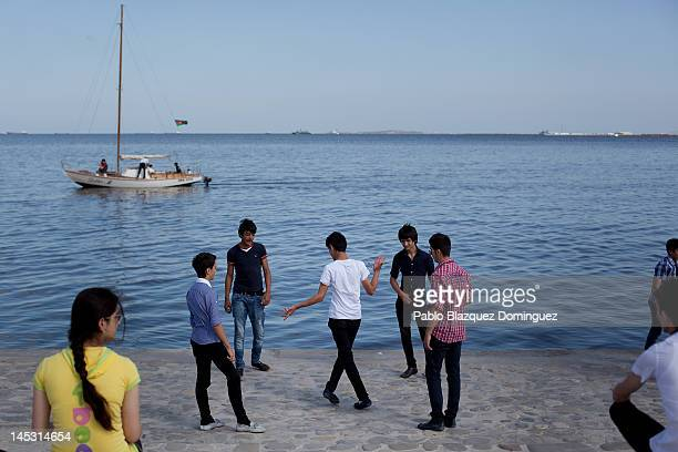 Members of the public dance next to the sea hours before the Eurovision Song Contest Grand Final at Euro Village on May 26 2012 in Baku Azerbaijan