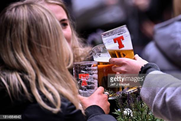 Members of the public enjoy a drink at the Three Sisters Pub in the Cowgate as lockdown measures are eased on April 26, 2021 in Edinburgh, United...
