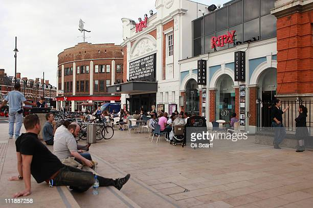 Members of the public enjoy a drink in the sunshine outside the Ritzy cinema in central Brixton on April 7 2011 in London England The 1981 Brixton...