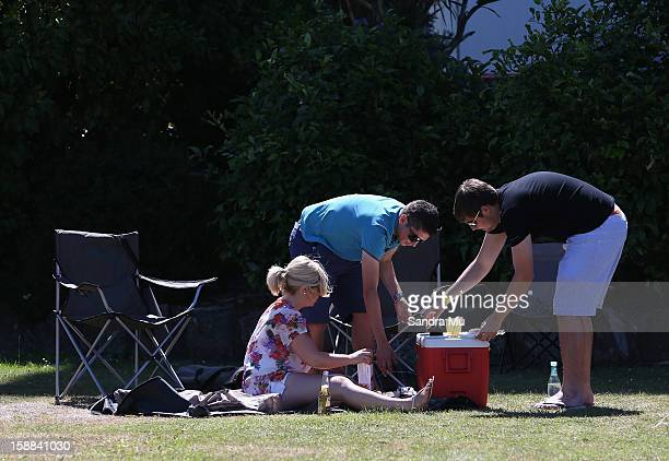 Members of the public enjoy a picnic during The Sound Championship Stakes at Ellerslie Racecourse on January 1 2013 in Auckland New Zealand