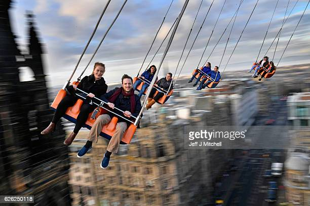 Members of the public enjoy a ride on the star flyer on November 28 2016 in Edinburgh Scotland The star flyer is one of a number of rides situated in...