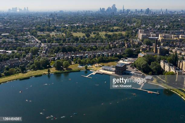 Members of the public enjoy an outdoor swim at West Reservoir in Stoke Newington on August 07, 2020 in London, United Kingdom. Parts of England are...