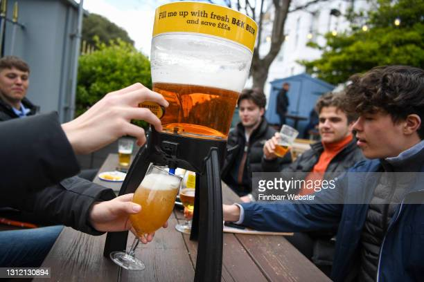 Members of the public enjoy food and a drink at Brewhouse & Kitchen pub at Southsea on April 12, 2021 in Portsmouth, England. England has taken a...