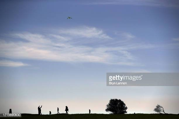Members of the public enjoy some fresh air at Devil's Dyke a National Trust beauty area on March 21 2020 in Poynings United Kingdom The National...