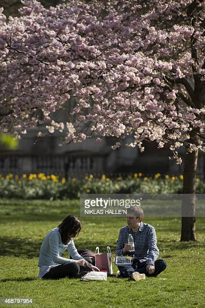 Members of the public enjoy the afternoon sunshine in Green park on April 7 2015 in London England N