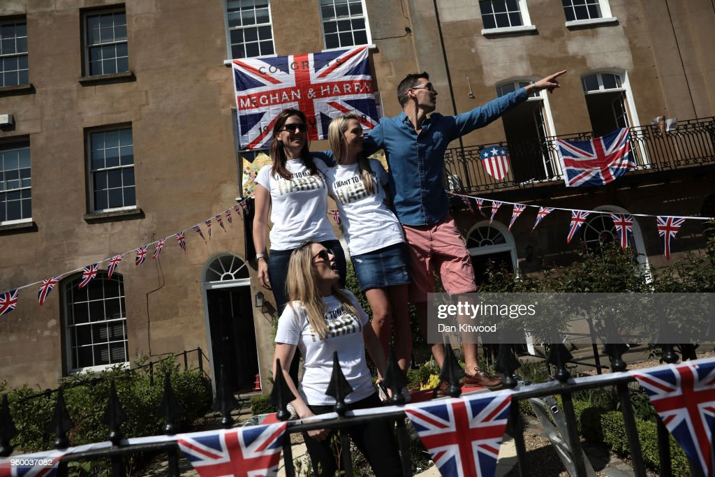 Members of the public enjoy the atmosphere near Windsor Castle prior to the wedding of HRH Prince Harry to Ms. Meghan Markle on May 19, 2018 in Windsor, England.