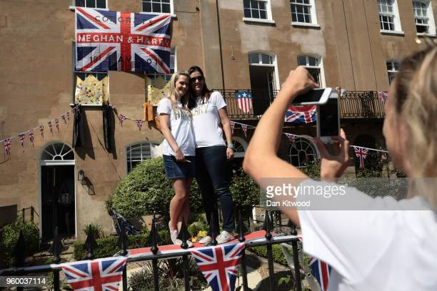 Members of the public enjoy the atmosphere near Windsor Castle prior to the wedding of HRH Prince Harry to Ms Meghan Markle on May 19 2018 in Windsor...
