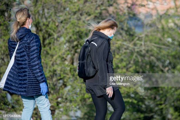 Members of the public enjoy the day's warm weather on Primrose Hill on April 5 2020 in London England The British government announced strict...