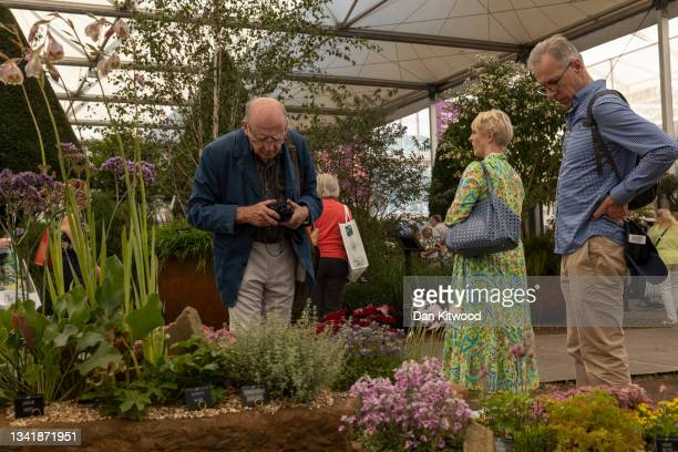 Members of the public enjoy the displays in the main pavilion at the Chelsea Flower Show on September 22, 2021 in London, England. This year's RHS...