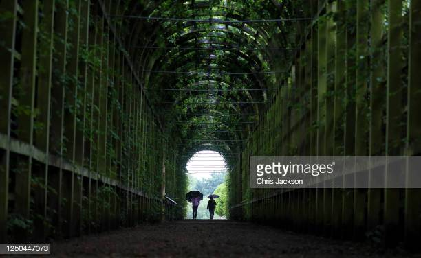Members of the public enjoy the gardens at the reopening of the Tudor gardens at Hampton Court Palace on June 18, 2020 in London, England. In line...