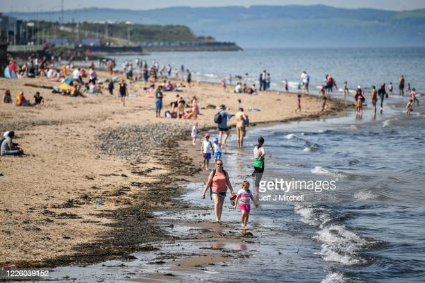 Members of the public enjoy the hottest day of the year on May 20, 2020 in Edinburgh, Scotland. The British government has started easing the...