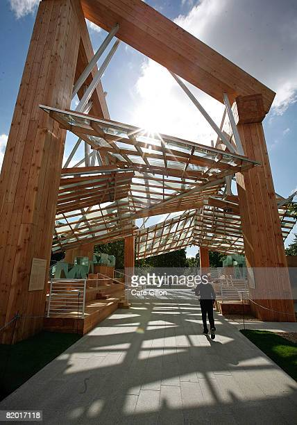 Members of the public enjoy the Serpentine Gallery Pavilion 2008 which is a wooden timber structure designed by the architect Frank Gehry on July 21...