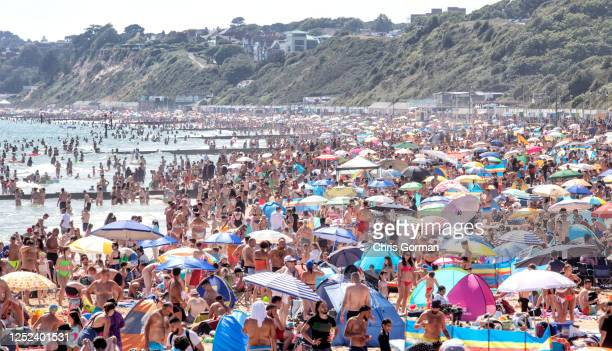 Members of the public enjoy the sunshine on Bournemouth Beach on June 242020 in BournemouthEnglandThe UK is experiencing a summer heatwave with...