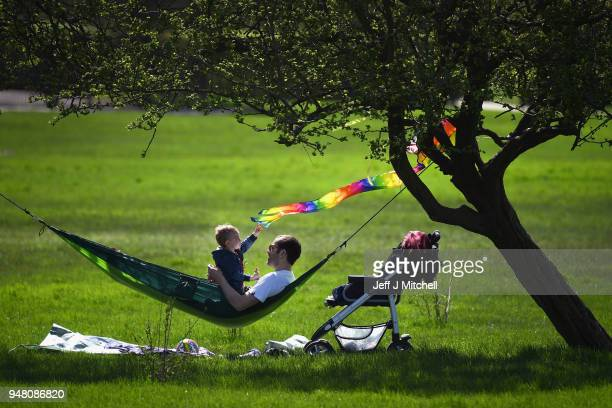 Members of the public enjoy the sunshine on Primrose Hill as spring temperatures arrive on April 18 2018 in London England London is expected to be...