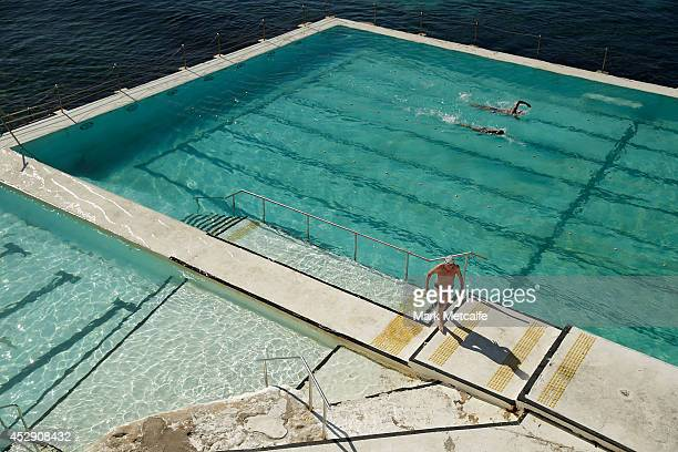 Members of the public enjoy the warm weather at Icebergs Bondi Beach on July 30 2014 in Sydney Australia Sydney forecast to hit 23 degrees in the...