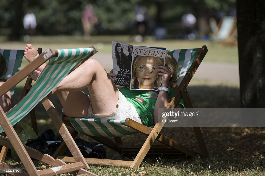 Members of the public enjoy the warm weather in St. James's Park on July 16, 2014 in London, England. The Met Office has issued a heatwave alert as temperatures throughout England and Wales are predicted to reach their highest level of the year this weekend.
